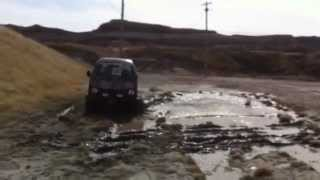 Daihatsu Hijet in slippery clay