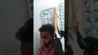 Cutting nice hairstyle in Kenya