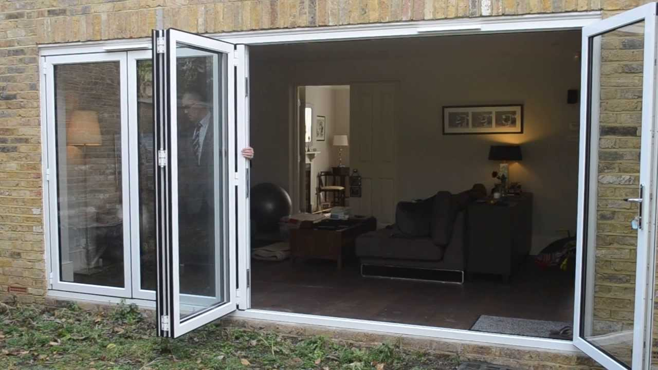 Bifold door: 5 panel white aluminium - YouTube