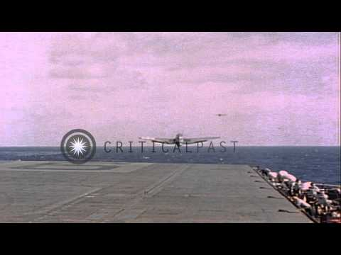 TBF Avenger, Douglas SBD Dauntless, and F6F Hellcats take off from the USS Lexing...HD Stock Footage
