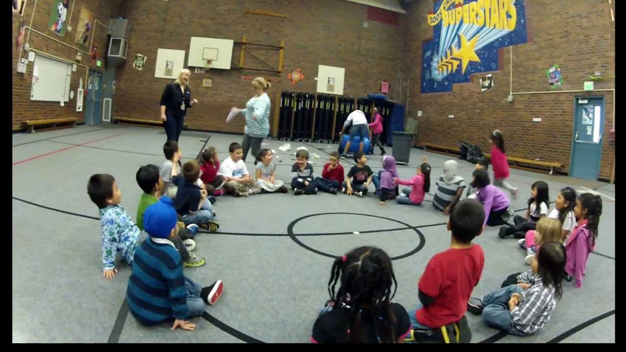 Kindergarten Kids Playing Duck Duck Goose on Earth Day