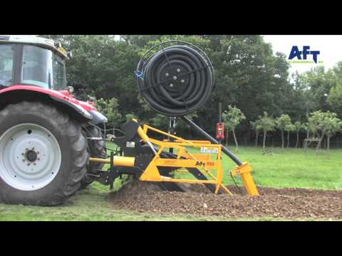 AFT 100 tractor mounted trencher with vertical pipe reel http://www.trenchers.co.uk