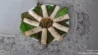 Закуска-трубочки из плавленого сыра пластинами.