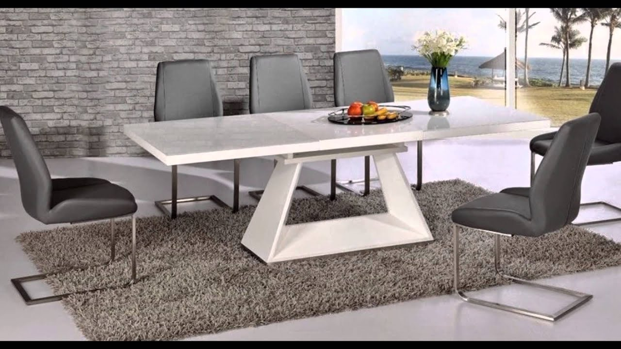 Extending glass dining table and 8 chairs