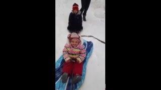 Toddler on a biggest snow slide