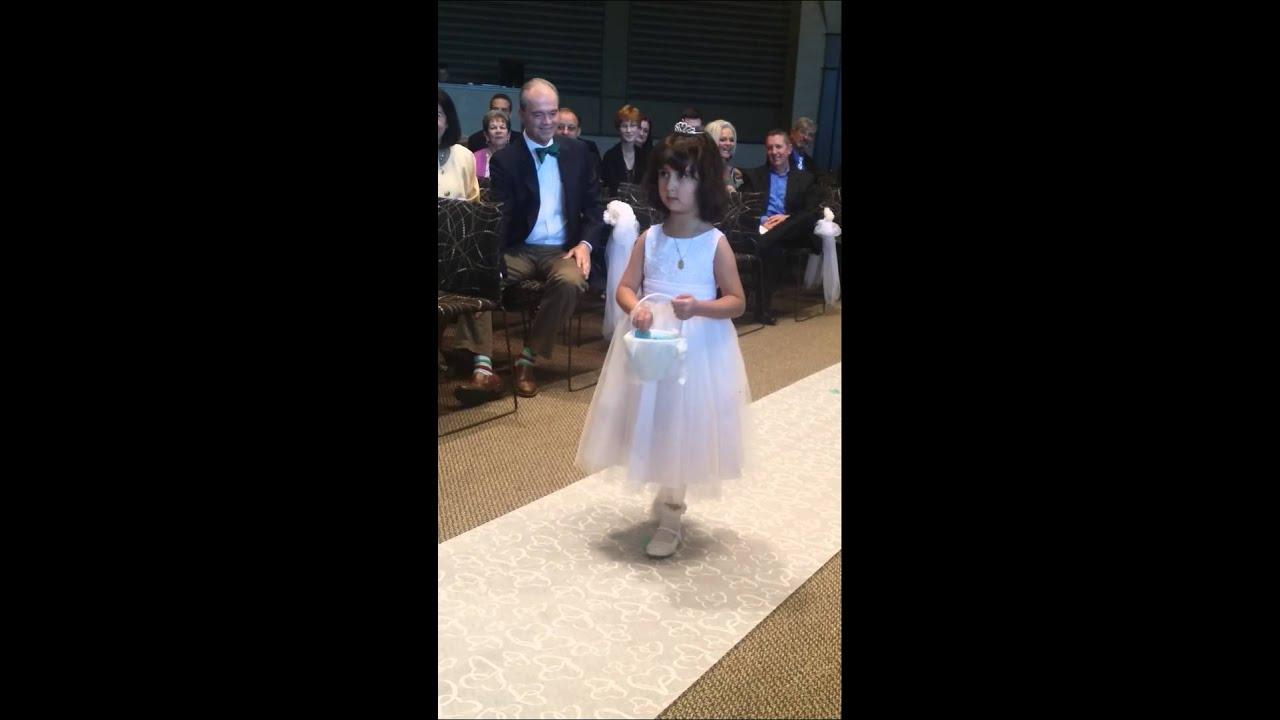 Flower Girl Walking Down the Aisle