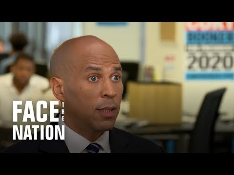 Booker details proposals on health care and immigration