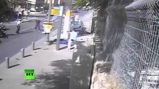 CCTV: Palestinian man rams car into bus stop, then attacks pedestrians with machete-like weapon