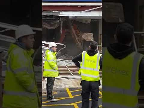 Driver of digger goes crazy at a Travel Lodge