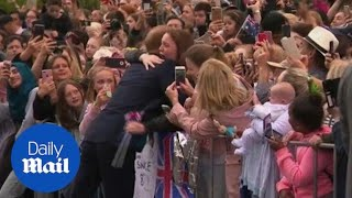 Girl bursts into tears of joy after receiving a hug from Prince Harry