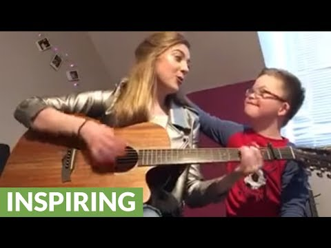 Girl plays original song for brother with down syndrome