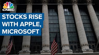 Stocks extend gains as Apple and Microsoft send Nasdaq to record high