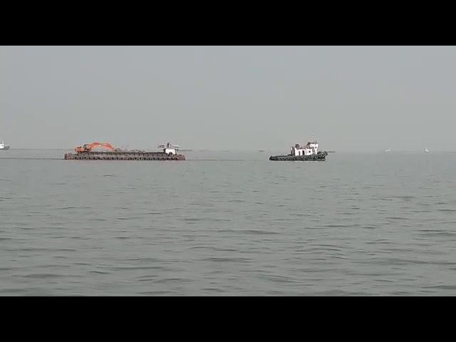Tug Towing Barge