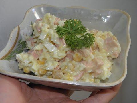 Рецепт Салат из рыбных консервов с яйцами и рисом на