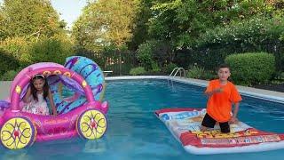 Heidi e Zidane fingem brincar com carruagem inflável de princesa