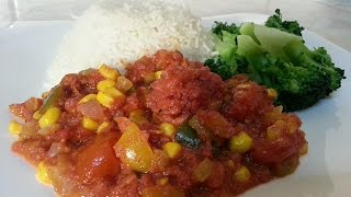 Jamaican Corn Beef With White Rice And Brocolli