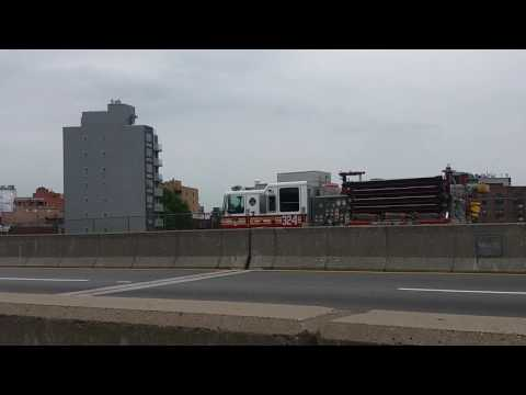 FDNY Engine 324 Going Back To Queens On The RFK Triborough Bridge In Queens, New York