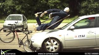 Pedestrian on bike gets hit by car in slow motion  - ITAI Video