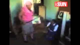 School girl  beaten with a Sjambok (heavy leather whip)