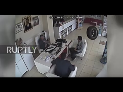Turkey: CCTV captures dislodged car TIRE flying into group INSIDE pharmacy