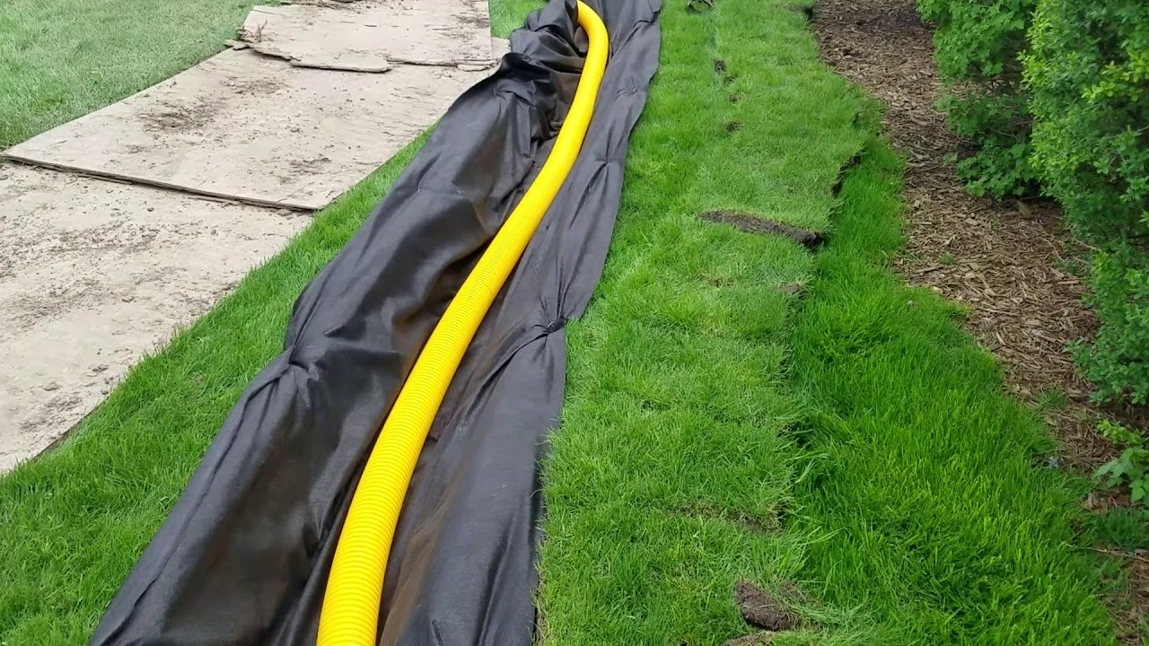 Do Not Use a Pipe Wrapped in Filter Fabric For a French Drain in MI - Yard  Drainage Contractor