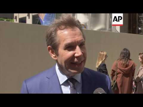 Jeff koons unveils 'Seated Ballerina' in Rockefeller Center