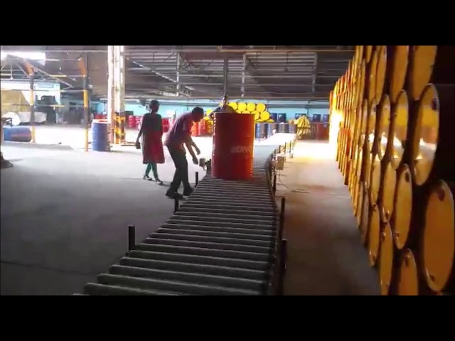 60 meter long Expandable Flexible Motorized Roller Conveyor Conveying Oil Drums at Indian Oil Site