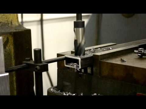 Drilling a 1in hole in steel tubing