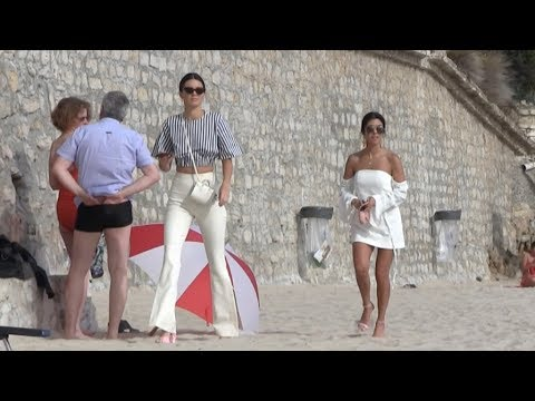 Exclusive - Kendall Jenner and Kourtney Kardashian take a walk on the beach in Cannes