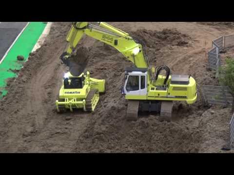 Liebherr 944B demolition swinging dirt at the road construction site