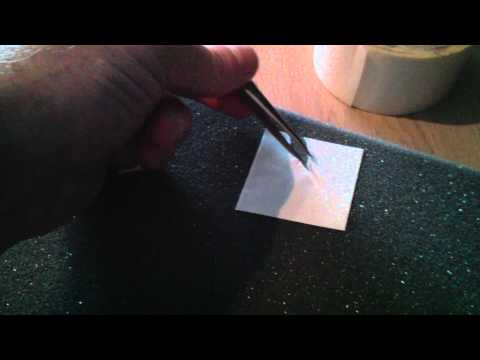 Removing the backing from double-sided sticky tape. Quickly!