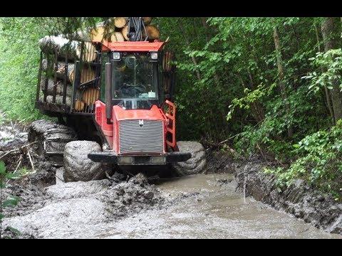 Valmet 840.3 logging in rainy summer forest, big load