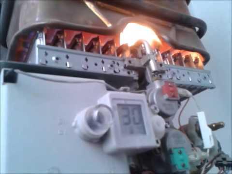 calentador con mala combustin en el quemador llama