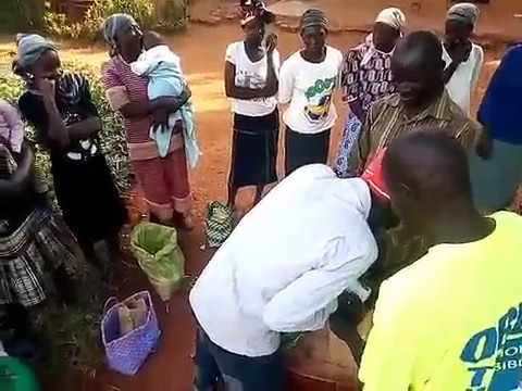 Widows Receiving Milk and Food - GMFC/WFF Sega Siaya Kenya