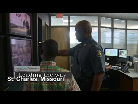 Local police captain mentors a young boy from Uganda