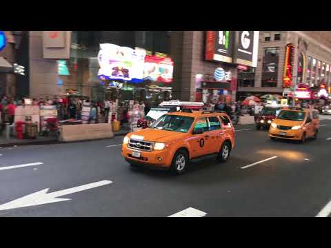 2 FDNY EMS GATORS RESPONDING ON 7TH AVENUE IN TIMES SQUARE, MANHATTAN, NEW YORK CITY.