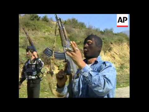 Albania: Saranda:  rebels show off their weapons, including a tank and grenades. - 1997