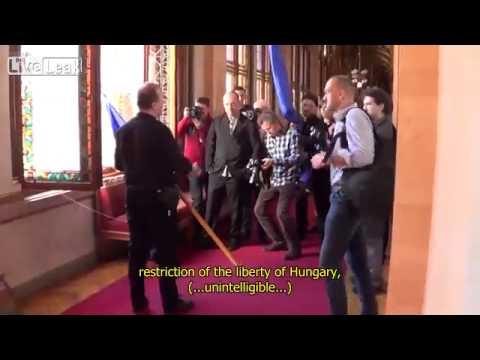 LiveLeak - Hungarian Jobbik member of parliament throws away EU flag