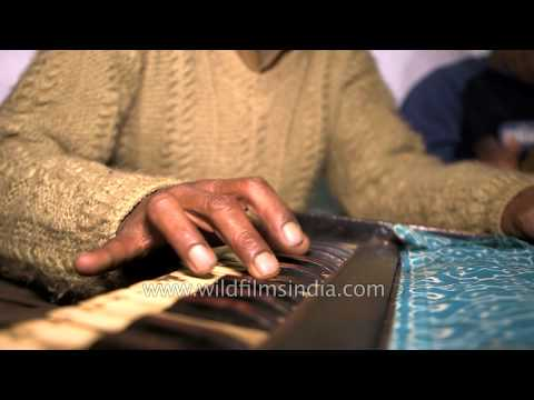 Man playing harmonium, a uniquely Indian instrument