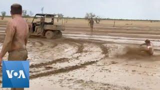 Australians Celebrate in Mud as Rain Falls on Drought-Stricken Queensland
