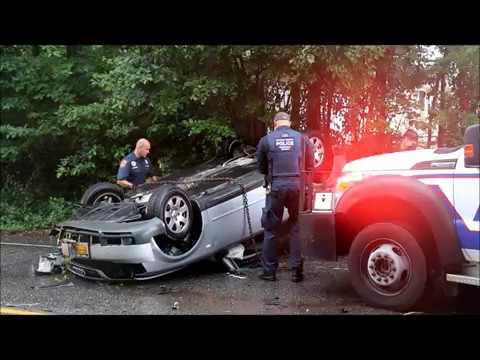 CAR OVERTURNS IN LAKE RONKONKOMA NY