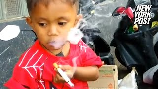 Tokin' tot smokes two packs a day