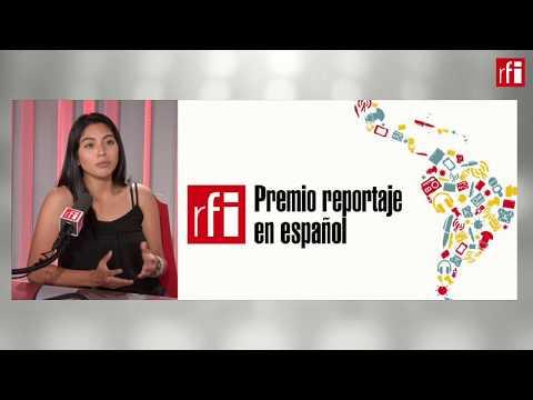 Valeria Reyes, premio de reportaje de RFI, con Jordi Batallé