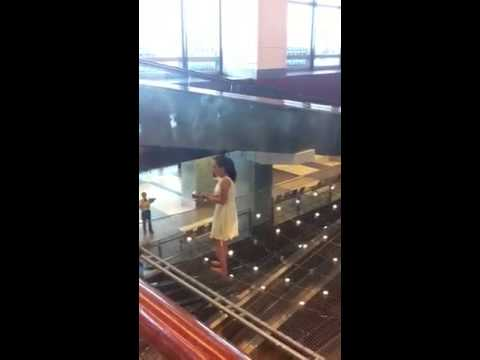 Woman damages Kinetic Rain sculpture at Changi airport