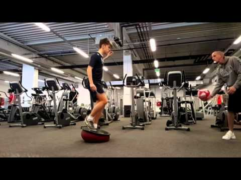 Stabilization exercise with youth Soccer Player