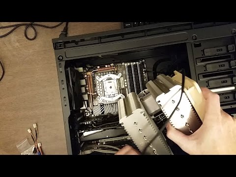 Noctua NH-D14 CPU cooler installation onto a Intel CPU and motherboard
