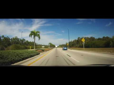 Driving on Alico Road - Fort Myers, Florida past several mines to Corkscrew