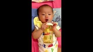Baby drinking water by himself at 5 months old