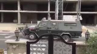 اقتحام مدينة رام الله ومحاصرة بناية سكنية
