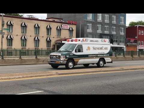 SENIOR CARE EMS AMBULANCE RESPONDING ON QUEENS BOULEVARD IN WOODSIDE, QUEENS IN NEW YORK CITY.